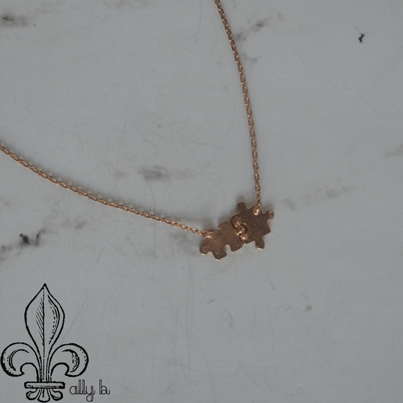 Jewelry - 🧩Rose gold puzzle piece necklace🧩